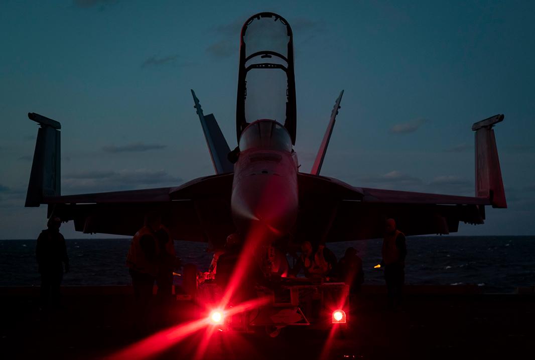 An F/A-18E Super Hornet takes off from the flight deck of USS Dwight D. Eisenhower (CVN 69)